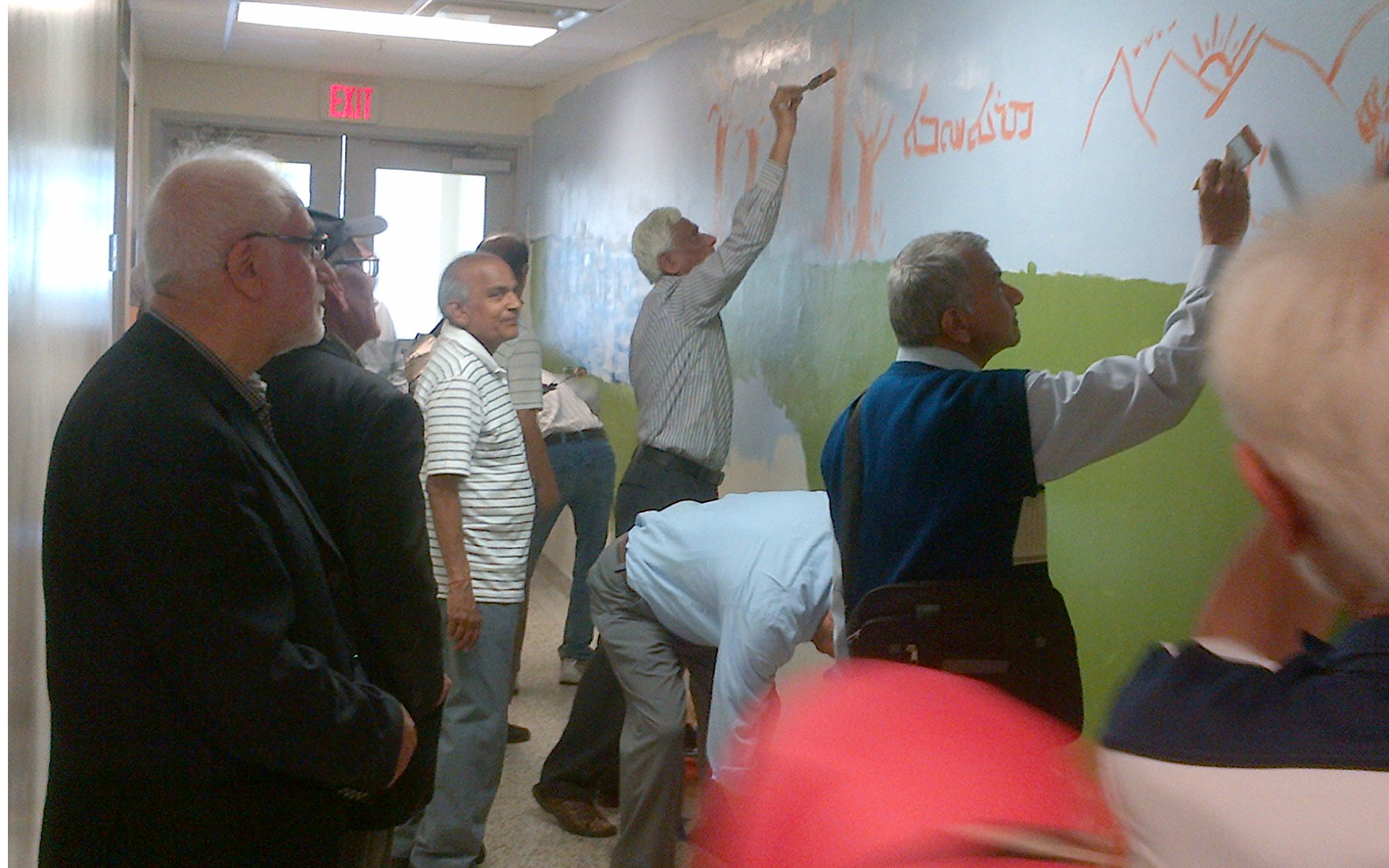 Seniors helping to paint a mural